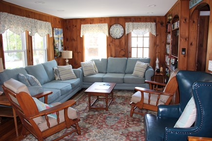 Dennis Port Cape Cod vacation rental - Well lit living room with lots of seating.  Flat screen smart tv.