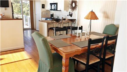 South Wellfleet Cape Cod vacation rental - Dining area with kitchen in background