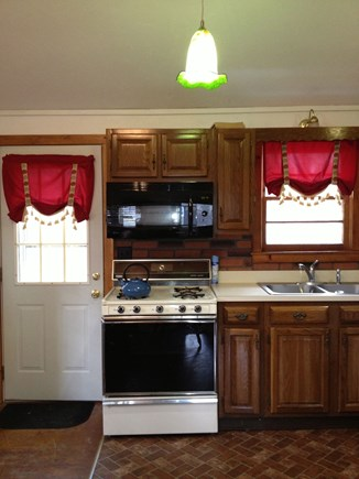 Dennis Port Cape Cod vacation rental - Kitchen stove back door