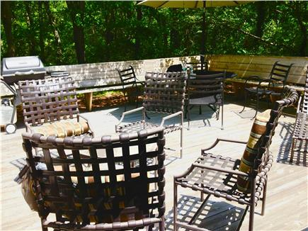Centerville Centerville vacation rental - Deck wrap around seating dining table lounging chairs