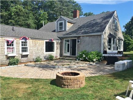North Falmouth Cape Cod vacation rental - Outdoor patio, fire pit & grille, adirondack chairs not pictured