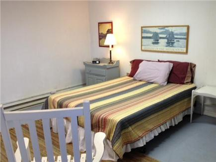 Truro Cape Cod vacation rental - Red bedroom lower level with queen bed