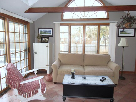 Dennis Port Cape Cod vacation rental - The family room is right off dining with door to deck on left