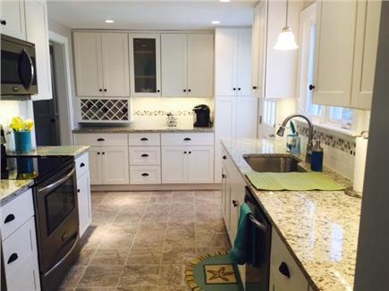 Brewster on Orleans border Cape Cod vacation rental - Kitchen with tile floors, granite, stainless appliances, Keurig