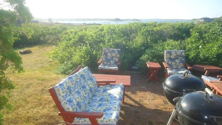 North Chatham Cape Cod vacation rental - Sunset grilling on the Patio w/ View of Pleasant Bay - June 2020