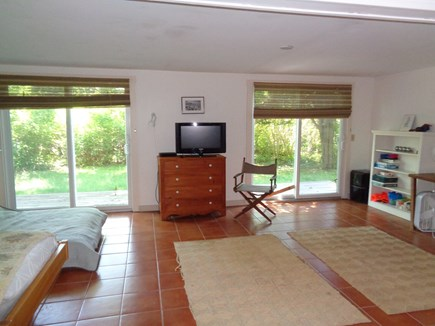 Wellfleet Cape Cod vacation rental - Open area with 2 twin beds and a double size futon with sliders