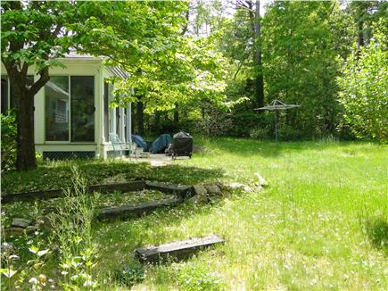 Brewster Cape Cod vacation rental - Exterior view of the sun porch and backyard.