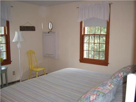 South Dennis Cape Cod vacation rental - Master bedroom has king bed, dresser and vanity/desk.