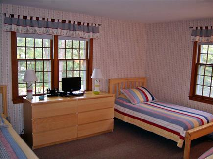 South Dennis Cape Cod vacation rental - Bedroom has three twins, two dressers and small HD-TV w/DVD