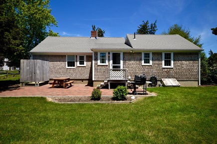 Orleans, Eastham Cape Cod vacation rental - Back of home- BBQ Grill, outdoor dining and outdoor shower