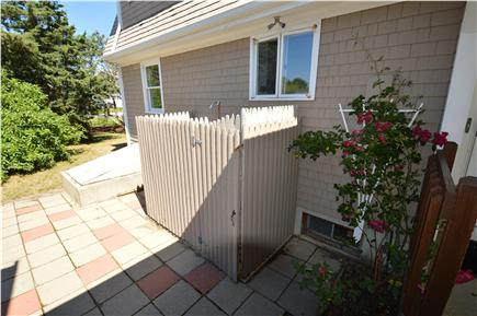 Barnstable  Cape Cod vacation rental - Outdoor shower and patio with grill.
