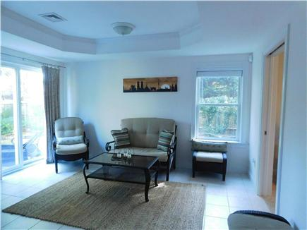 Hyannis Cape Cod vacation rental - Sitting area off outdoor patio.  Wet bar/full size refrigerator
