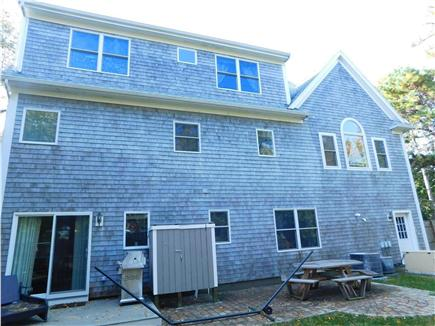 Hyannis Cape Cod vacation rental - Outdoor shower, patio, gas grill, picnic table, fenced backyard