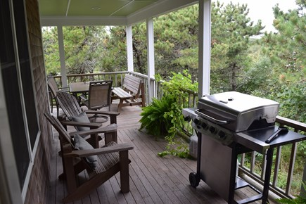 Truro Cape Cod vacation rental - Huge wraparound farmers porch, new gas grill, views of treetops.