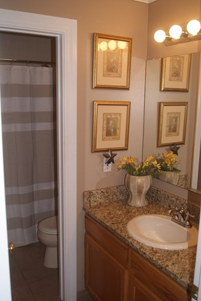 Brewster Cape Cod vacation rental - Second floor main bath - new tile and granite counter.