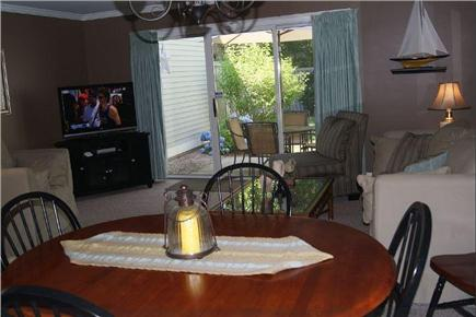 Brewster Cape Cod vacation rental - Living area view from Kitchen - slider to patio.
