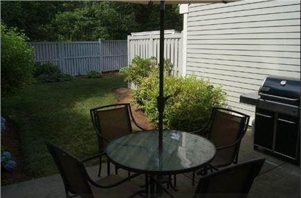 Brewster Cape Cod vacation rental - Outdoor patio with large gas grill and umbrella table.