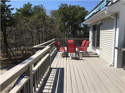 N. Truro Cape Cod vacation rental - Huge deck with table and 8 chairs for wonderful meals outdoors