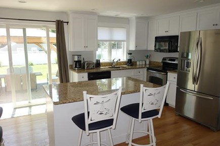 South Yarmouth Cape Cod vacation rental - Modern kitchen opens to the lovely back deck and yard.