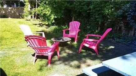 South Yarmouth Cape Cod vacation rental - Side yard with fire pit
