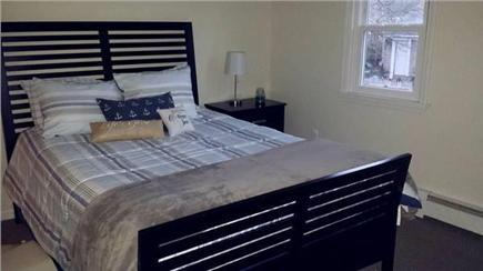 South Yarmouth Cape Cod vacation rental - Master bedroom with queen bed and wall mount tv