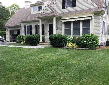 Mashpee, Popponesset Cape Cod vacation rental - Large yard with many flowers and shrubs