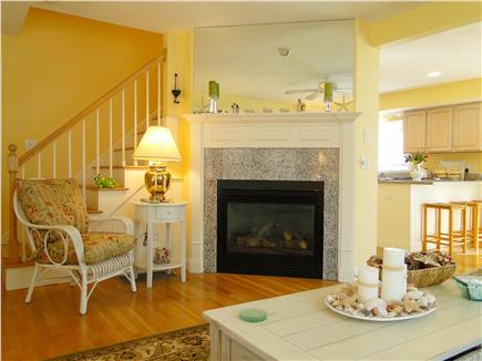 Mashpee, Popponesset Cape Cod vacation rental - Living room fireplace, opens to dining/kitchen