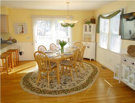 Popponesset Cape Cod vacation rental - Dining area with flat screen TV, slider to deck