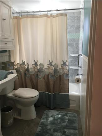 Dennisport Cape Cod vacation rental - 2nd floor bathroom with marble tiles