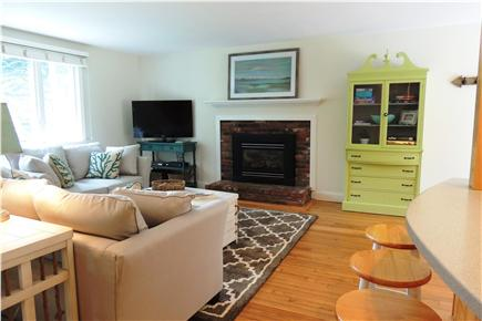 Harwich Cape Cod vacation rental - Living room view with TV and fireplace