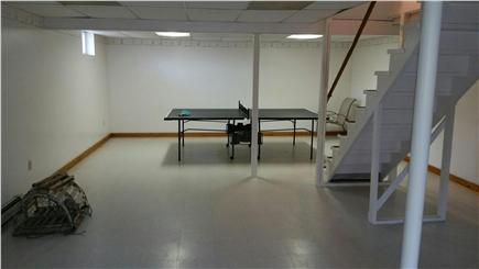 Eastham Cape Cod vacation rental - Basement ping pong table, sectional couch and full bathroom