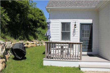North Truro Cape Cod vacation rental - Back porch with table, chairs, grill.