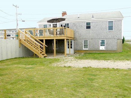 Wellfleet Cape Cod vacation rental - Back view of cottage with new deck and stairs to parking area