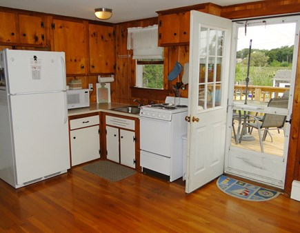 Wellfleet Cape Cod vacation rental - Kitchen area, opens to back deck