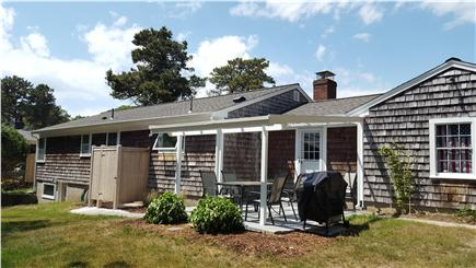 South Harwich Cape Cod vacation rental - Upper patio, outdoor shower, & walkout lower patio beyond