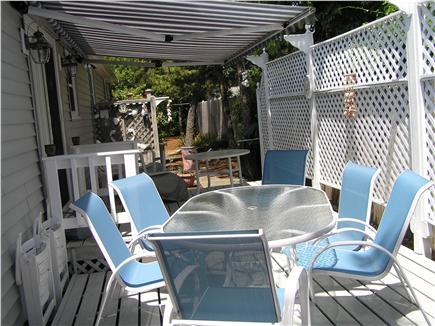 Dennisport Cape Cod vacation rental - Spacious deck with tables, chairs and awning for relaxing daily