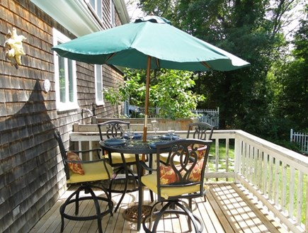 Brewster Cape Cod vacation rental - Deck area with grill, overlooks back yard