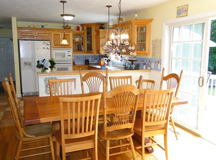 Brewster Cape Cod vacation rental - Spacious dining room opens to kitchen and back deck area