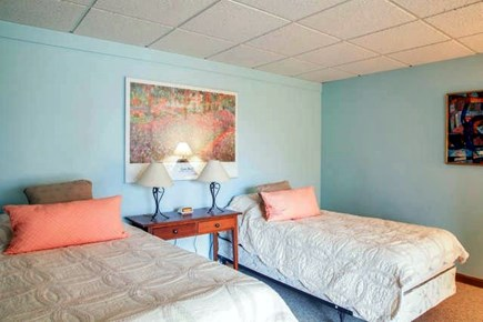 Brewster Cape Cod vacation rental - The downstairs bedroom has two single beds.