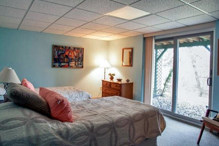 Brewster Cape Cod vacation rental - Downstairs bedroom has a sliding glass door out to front yard.