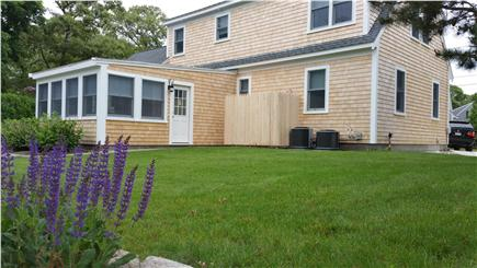 Harwichport Cape Cod vacation rental - Back of house showing outdoor shower and restful backyard