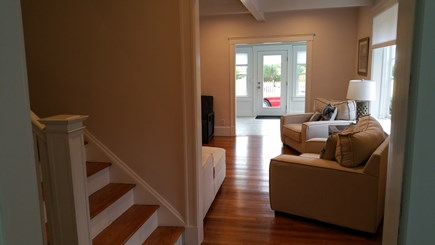 Harwichport Cape Cod vacation rental - Front foyer and living room with sunroom and pool beyond
