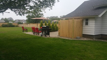 Harwichport Cape Cod vacation rental - Spacious outdoor dining/grilling area with large outdoor shower