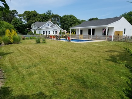 Harwichport Cape Cod vacation rental - Newly completed 3 br poolhouse (main house in the background)