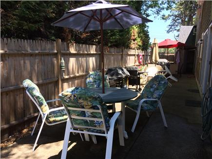 Dennis Port Cape Cod vacation rental - Grill on patio Weber grill with table and comfortable chairs