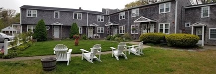 Dennis Port Cape Cod vacation rental - Front area of Condo with adirondack chairs