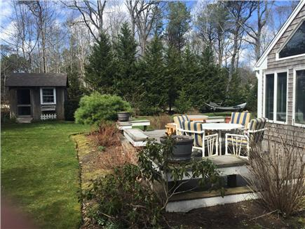 Brewster Cape Cod vacation rental - Deck view, with a storage shed (l) for bikes and beach toys