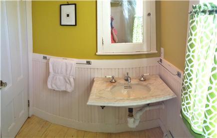 Truro Cape Cod vacation rental - 1st floor bath, 19th century claw tub and marble wall sink