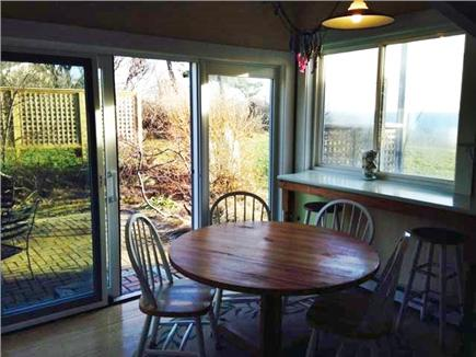 Truro Cape Cod vacation rental - Kitchen butcher block table w 6 chairs; patio dining beyond