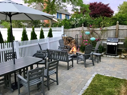 Chatham downtown village Cape Cod vacation rental - Private patio w/ dining, firepit (wood incl), grill & shower